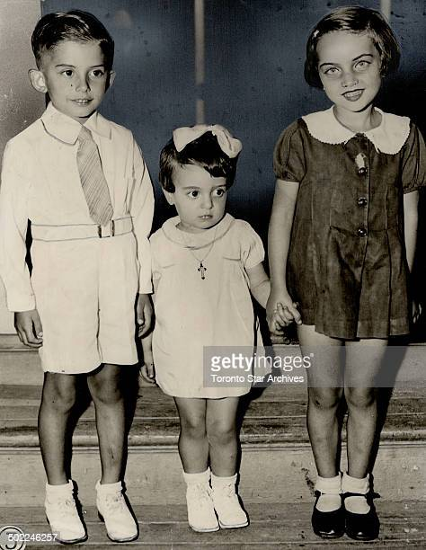 Marathon. Ronald Bagnato; 5; Anielo Spizzirri; 2; and Joan Cavatti; 6; grandchildren of Mr. And Mrs. Bagnato; who all know of the baby marathon; and...
