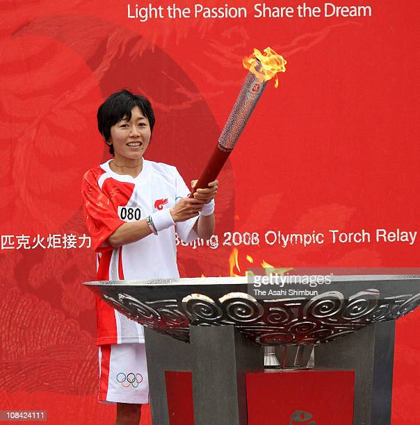 Marathon runner and the final runner of Beijing Olympic Nagano torch relay Mizuki Noguchi lights the torch to the cauldron during the Beijing Olympic...
