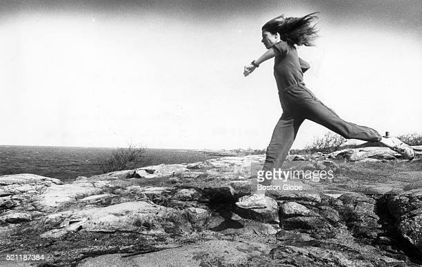 Marathon runner Bobbi Gibb who was the first woman to finish the Boston Marathon runs through the Headlands and by the Atlantic Ocean in Rockport...