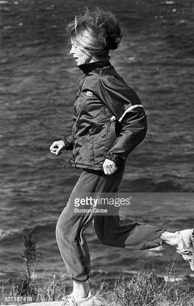 Marathon runner Bobbi Gibb who was the first woman to finish the Boston Marathon runs in Rockport Mass March 25 1983