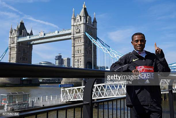 Marathon runner Ethiopia's Kenenisa Bekele poses for a photograph near Tower Bridge in central London on April 20 2016 during a photo call ahead of...