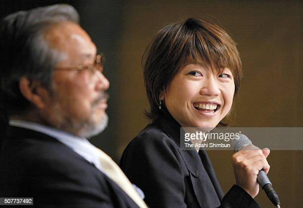 Marathon runner Naoko Takahashi and her coach Yoshio Koide attend a press conference on May 9 2005 in Tokyo Japan