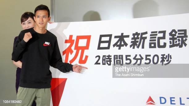 Marathon runner Suguru Osako poses for photographs on arrival at Narita International Airport on October 10 2018 in Narita Chiba Japan