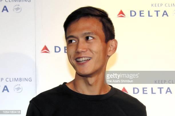 Marathon runner Suguru Osako speaks to media reporters on arrival at Narita International Airport on October 10 2018 in Narita Chiba Japan