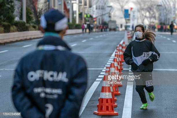 Marathon runner wears a face mask as she warms up before running the Tokyo Marathon on March 1, 2020 in Tokyo, Japan. The 2020 Tokyo Marathon has...
