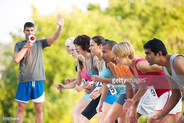 marathon runners at the starting line. - 5000 meter stock pictures, royalty-free photos & images