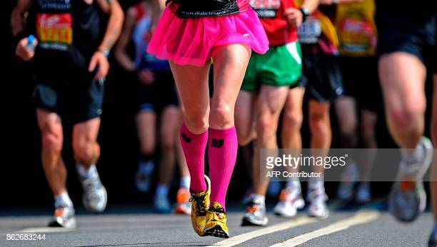Marathon runners compete in the 2011 London marathon, London on April 17, 2011. 36,500 runners took part in the annual event. AFP PHOTO/Carl de Souza...