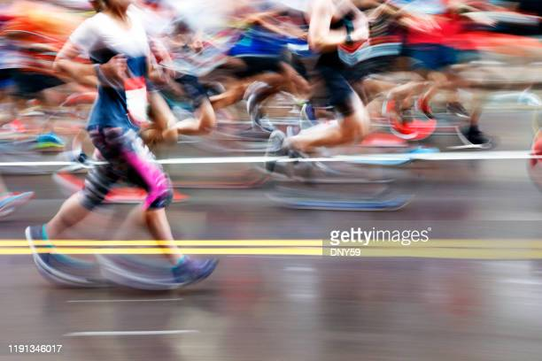 marathon runners in motion - marathon stock pictures, royalty-free photos & images