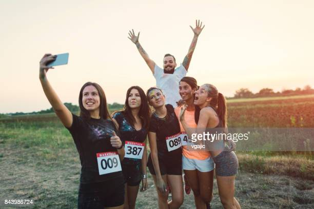 marathon runners making selfie - sports team event stock photos and pictures