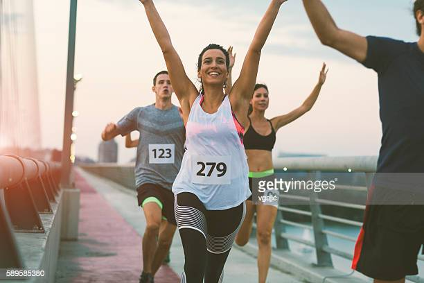 marathon runners. - finishing stock pictures, royalty-free photos & images