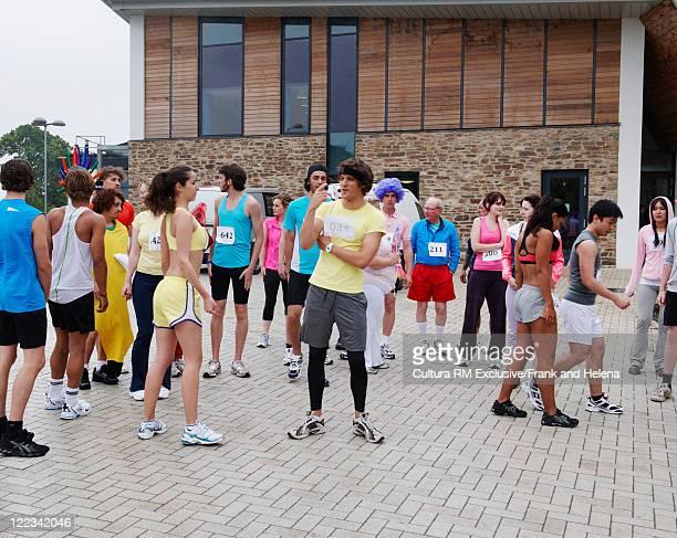 Marathon runners standing in square
