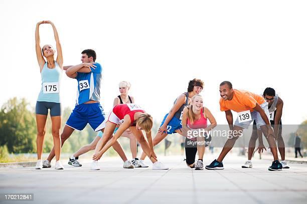Marathon runners stretching