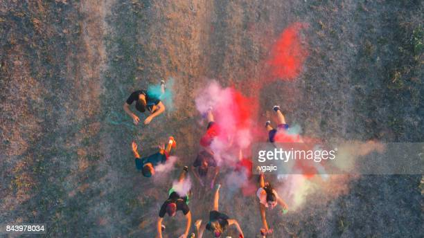 Marathon Runners Throwing Holi Colors