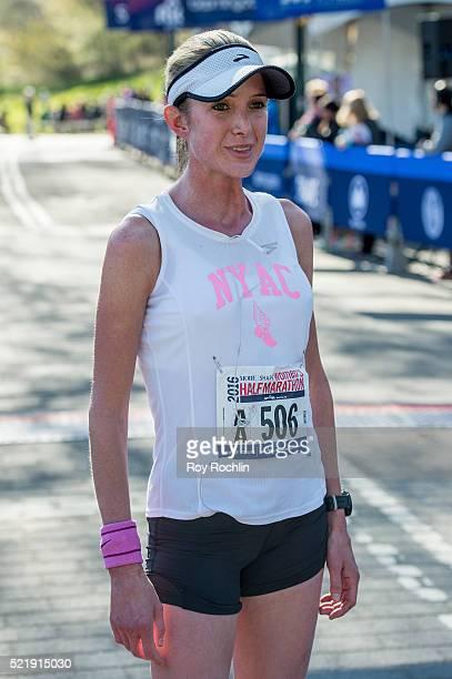 Marathon winner Caroline LeFrak as she crosses the fiinsh line during the 13th annual MORE/SHAPE Women's HalfMarathon at Central Park on April 17...