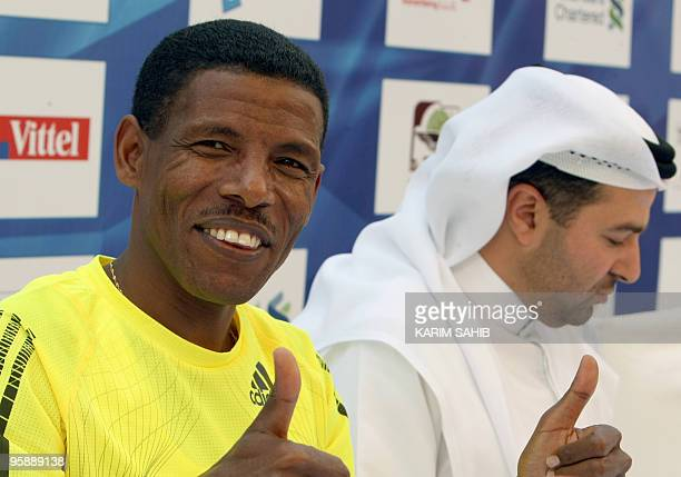 Marathon world record holder Haile Gebrselassie of Ethiopia gives a thumbsup sign during a press conference in Dubai on January 20 ahead of the Dubai...