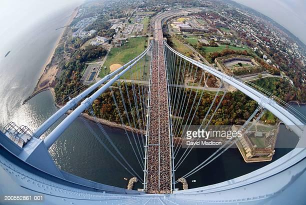 Marathoners running on Verrazano bridge, aerial view