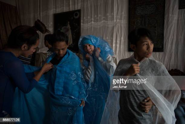 Marawi gay and transgender residents try on curtains to serve as gowns on October 20 2017 in Saguiaran southern Philippines Abnaim now lives as an...