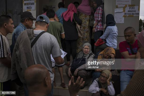 Marawi residents and local business owners flock to the provincial capitol to secure a safe passage permit on July 20 2017 in Marawi southern...
