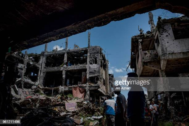 Marawi residents salvage any usable items they can find from what is left of their homes as they were allowed to enter for three days in what used to...