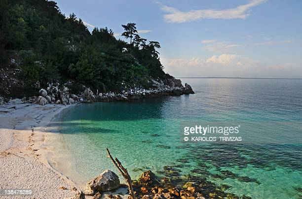 marble beach - thasos stock photos and pictures