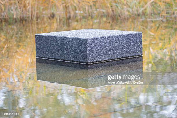 Marble Block Reflecting In Water