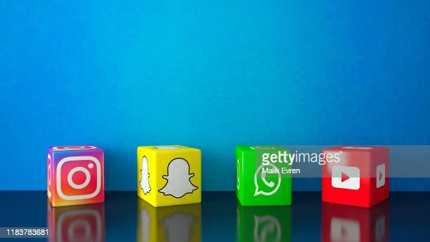 marble cubic social media services icons on black glass with blue copy space - community logo stock pictures, royalty-free photos & images