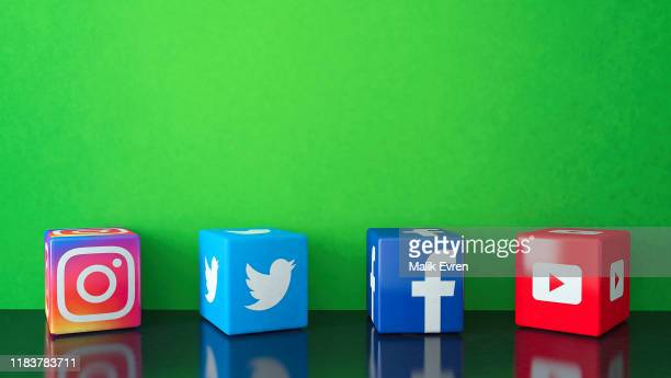 marble cubic social media services icons on black glass with green copy space - big tech stock pictures, royalty-free photos & images