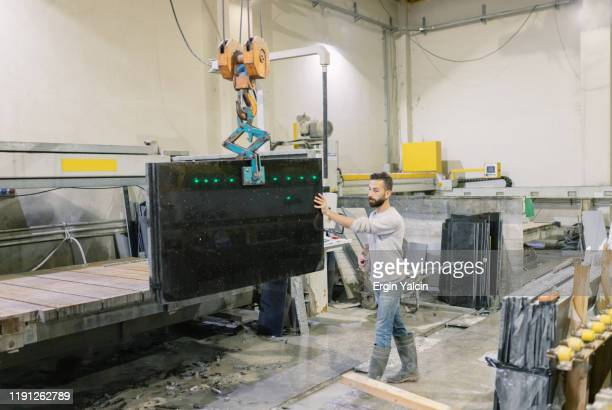 marble factory worker  with crane - crane construction machinery stock pictures, royalty-free photos & images