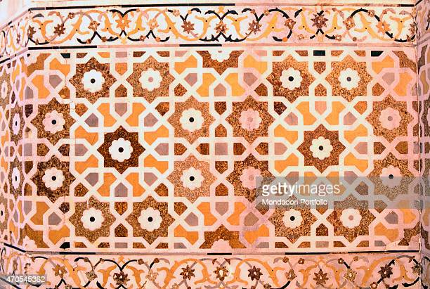 'Marble inlay by Mughal craftsmen 16221628 17th Century gemstone inlay on marble India Agra Whole artwork view An inlaid stone work adorns the outer...