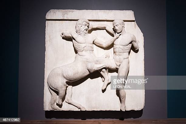 A marble metope sculpture from the Parthenon in Athens part of the collection that is popularly referred to as the Elgin Marbles depicting a battle...