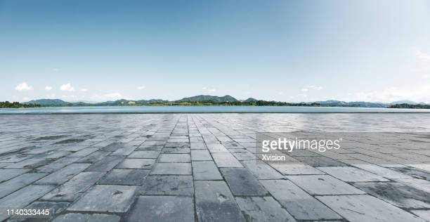 marble platform with mountains in the background - construction platform stock pictures, royalty-free photos & images