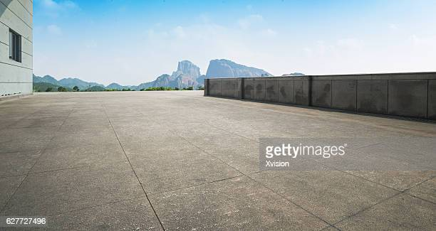 marble platform with mountains in the background - sports round stock pictures, royalty-free photos & images