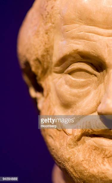 A marble sculpture of Aristotle dated from 330 BCE is displayed at the National Museum of Singapore in Singapore on Wednesday Jan 16 2008 Three small...