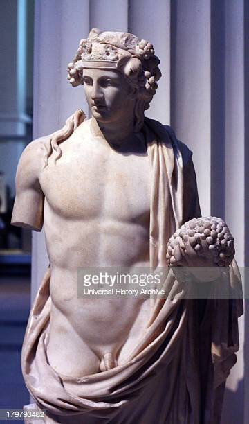 Marble sculpture of Dionysus god of wine shown holding a bunch of grapes Roman 2nd century AD Found in the Temple of Dionysus at Cyrene