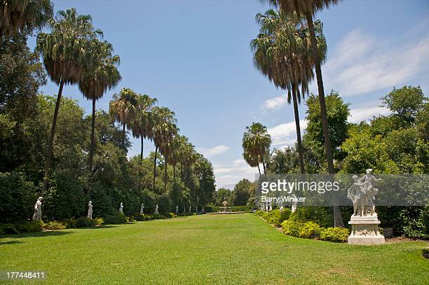 marble sculptures lining long green lawn - san marino california stock pictures, royalty-free photos & images