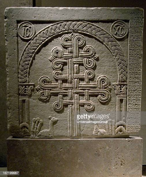 ART GREECE Marble slab with lateral inscription and reliefs about intertwined crosses Dated from latest XI century and early XII century Byzantine...
