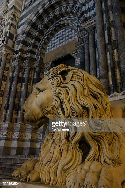 Marble statue of lion outside Duomo in Genoa, Italy