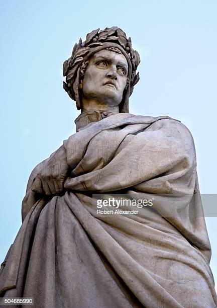 A marble statue of the Italian poet and writer Dante Alighieri is on the Piazza di Santa Croce in Florence Italy