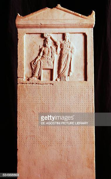 Marble stele with a relief showing the People of Athens being crowned by Democracy and inscribed with a law against tyranny passed by the people of...