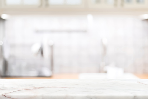 Marble stone countertop on blur kitchen interior background 925623242