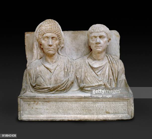 Marble tombstone of the doctor Claudius Agathemerus and his wife Myrtale circa 100 The doctor wears a Roman toga on his right his wife wears a high...