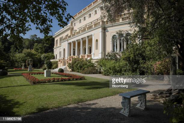 Marble urns and benches decorate the lawn in private gardens at the Villa Les Cedres a 187yearold000squarefoot 14bedroom mansion set on 35 acres in...
