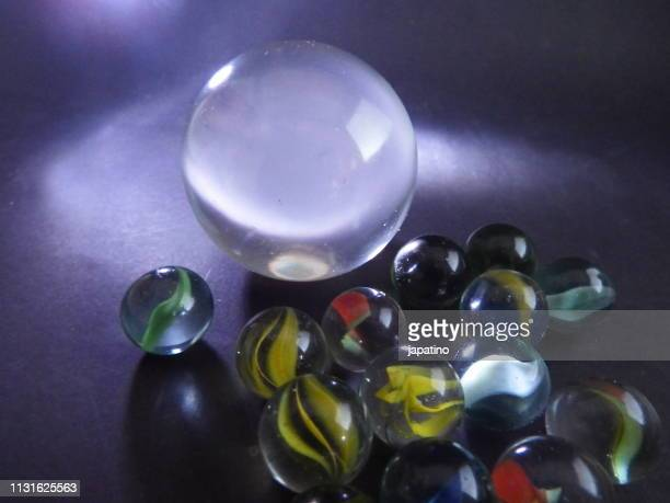 marbles of different colors with other abstract ones inside. - forma stock pictures, royalty-free photos & images