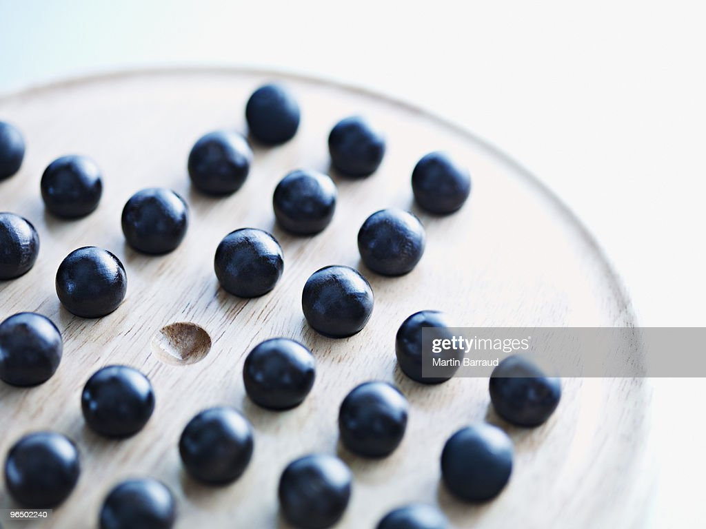 Marbles on Chinese checkers board : Stock Photo