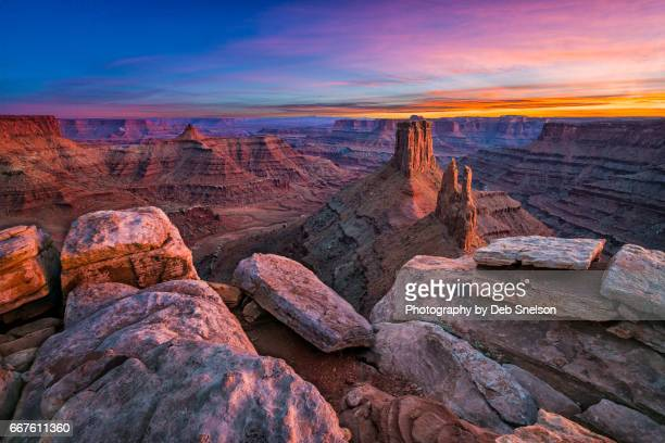 marboro point with reflected light after sunset - moab utah stock photos and pictures