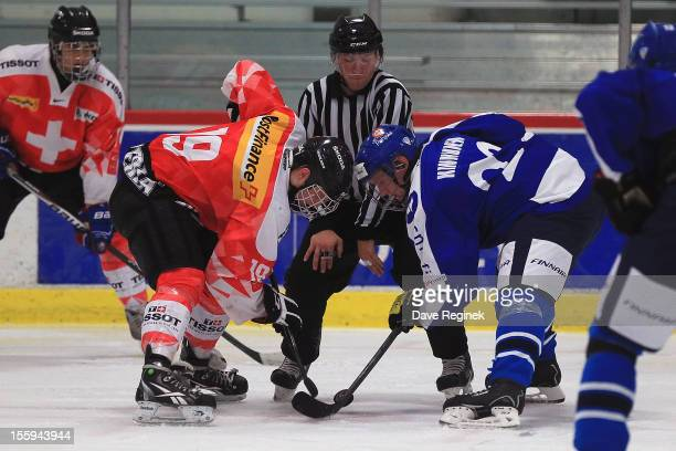 Marc Aeschlimann of Switzerland faces off against Saku Kinnunen of Finland during the U-18 Four Nations Cup tournament on November 9, 2012 at the Ann...