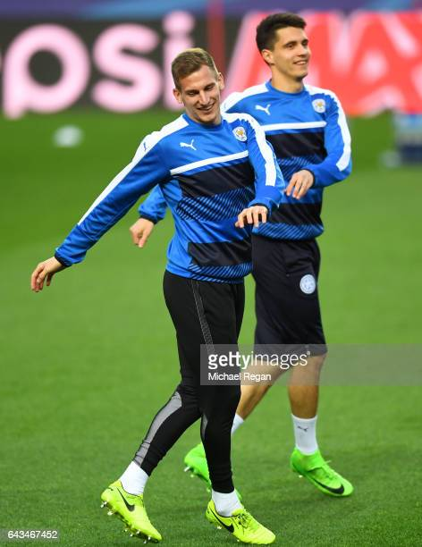 Marc Albrighton and Bartosz Kapustka of Leicester City take part in a training session ahead of the UEFA Champions League roundof16 first leg against...