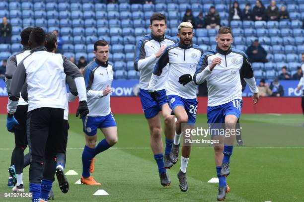 Marc Albrighton and Riyad Mahrez of Leicester City warm up ahead of the Premier League match between Leicester City and Newcastle United at King...