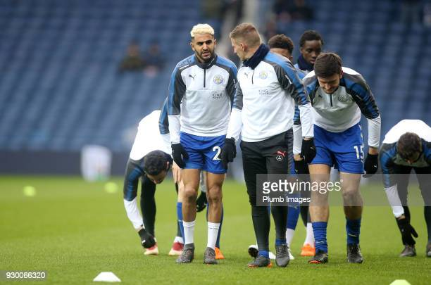 Marc Albrighton and Riyad Mahrez of Leicester City warm up at The Hawthorns ahead of the Premier League match between West Bromwich Albion and...