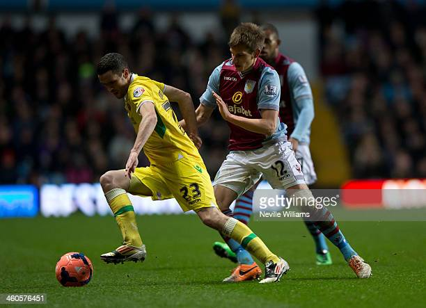 Marc Albrighton of Aston Villa is challenged by Jamie Murphy of Sheffield United during the FA Cup Third Round match between Aston Villa and...